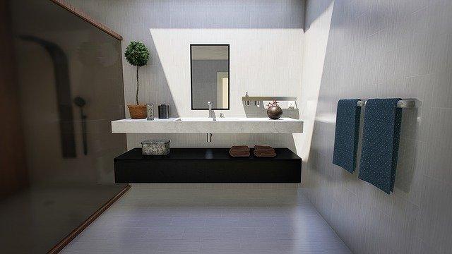 Op zoek naar een trendy badkamer met betonlook?
